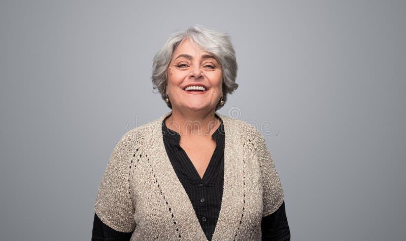 Laughing senior woman looking at camera royalty free stock photography