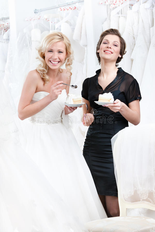 Laughing Shop Assistant And The Bride Royalty Free Stock Photography