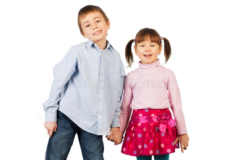 Laughing siblings. Cute laughing siblings on a white studio background royalty free stock photography
