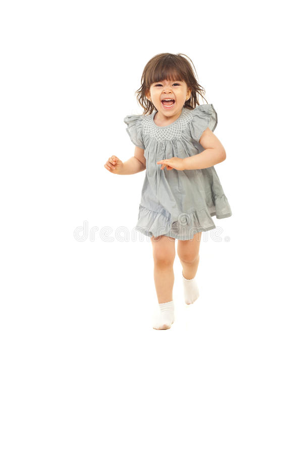 Laughing toddler girl running. Laughing cute toddler girl two years running isolated on white background royalty free stock images