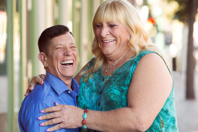 Laughing transgender couple outside royalty free stock image
