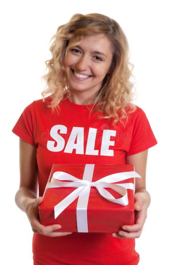 Laughing woman with blond hair and gift in a sales-shirt. On an isolated white background for cut out stock image