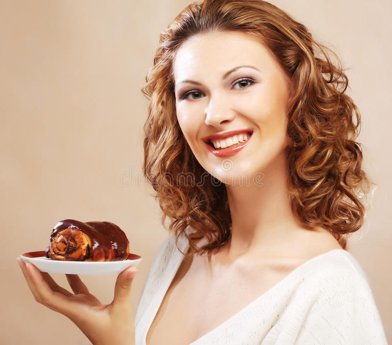 Laughing woman with cake. Happy laughing woman with cake royalty free stock photography