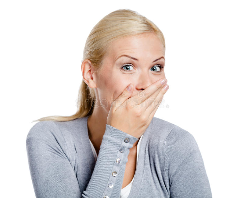 Laughing woman covers mouth with hand stock photo