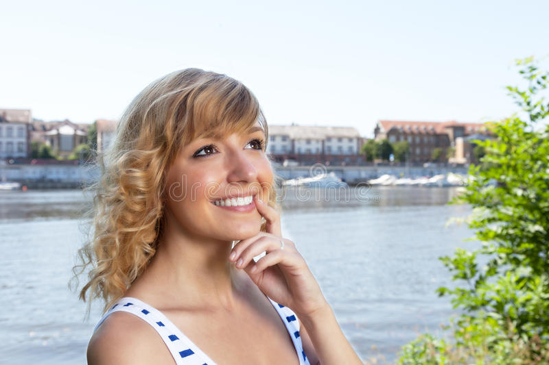 Download Thinking woman on a river stock photo. Image of daydreaming - 41759828