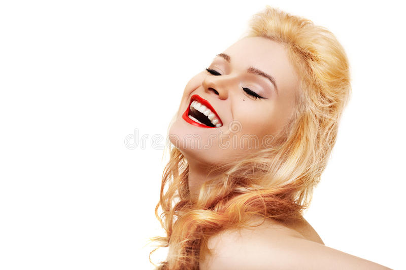 Laughing woman with red lips & healthy shiny hair. Laughing beautiful woman with red lips on white background stock photography
