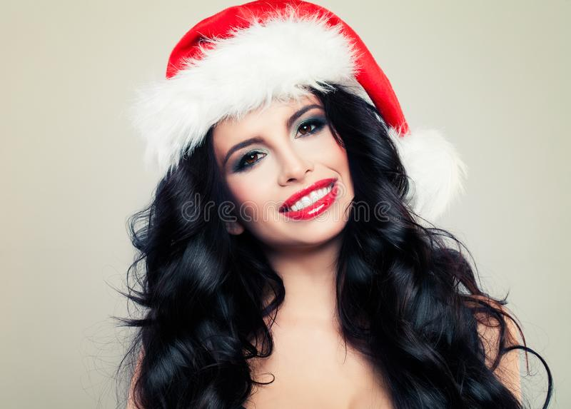 Laughing Woman in Santa Hat. Beautiful Christmas Girl royalty free stock image