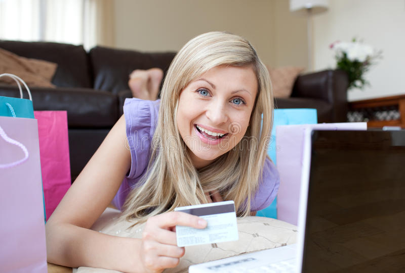 Download Laughing Woman Shopping Online Lying On The Floor Stock Image - Image: 13766599