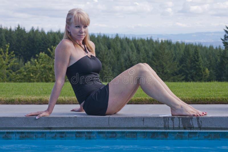 Laughing woman at swim pool royalty free stock photos