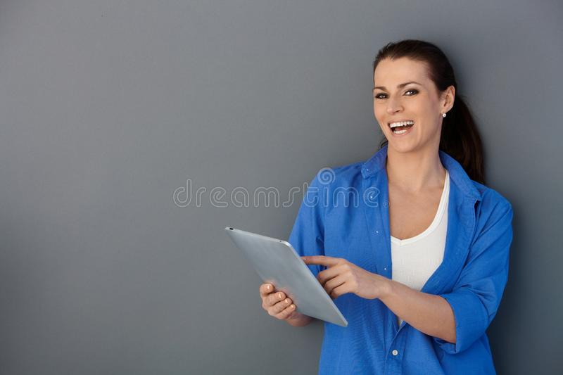 Download Laughing Woman With Touchscreen Pad Stock Image - Image: 20444937