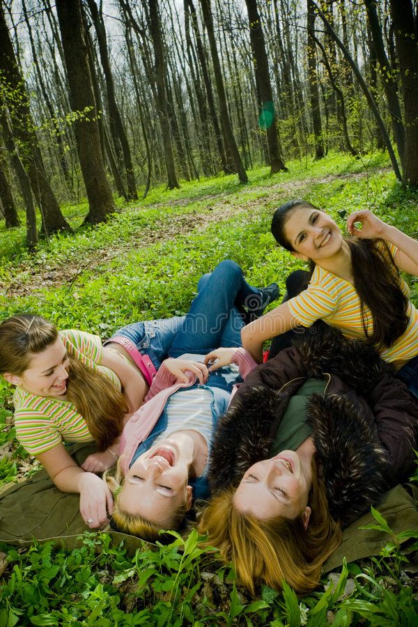 laughing women in forest stock image
