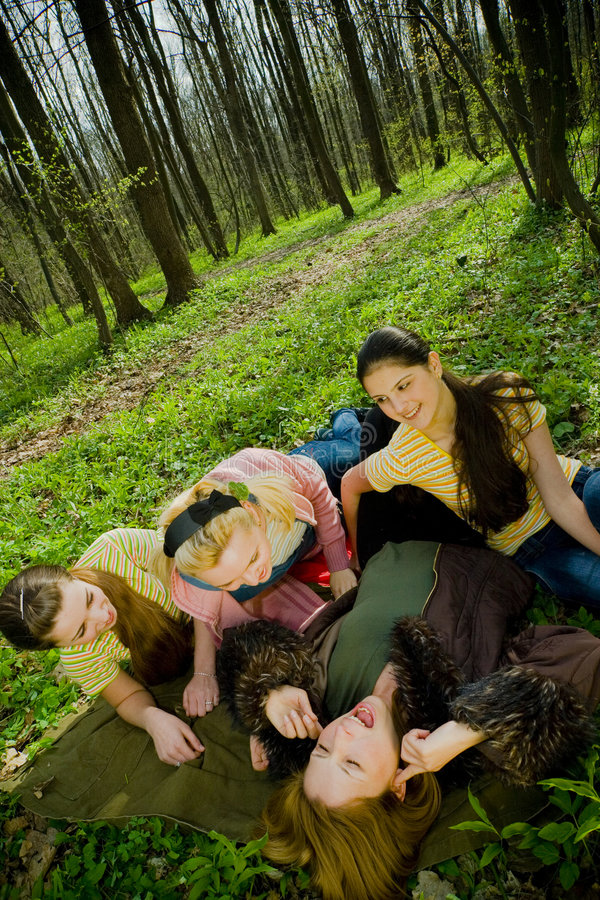 laughing women in forest royalty free stock photography