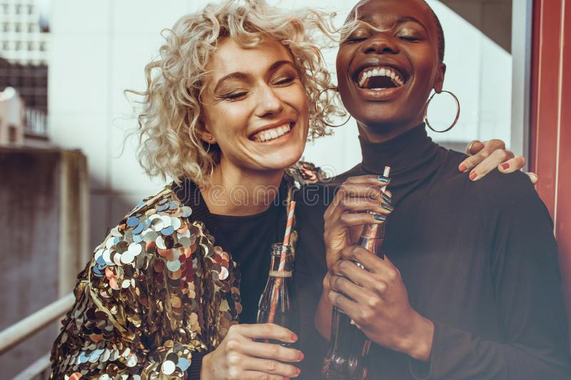 Laughing women friends enjoying themselves royalty free stock images