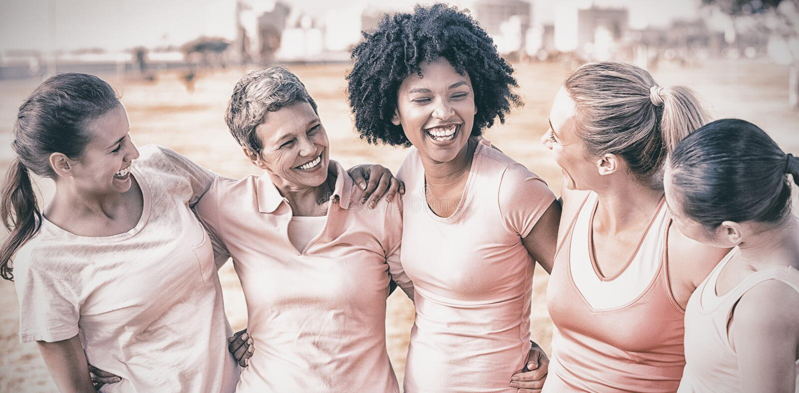 Laughing women wearing pink for breast cancer stock photos