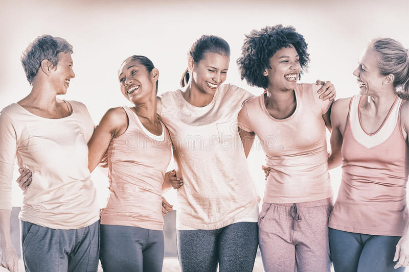 Laughing women wearing pink for breast cancer royalty free stock images