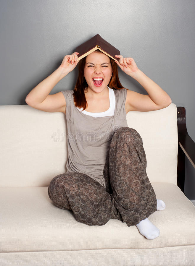 Download Laughing Young Woman With Book Stock Photo - Image: 18910352