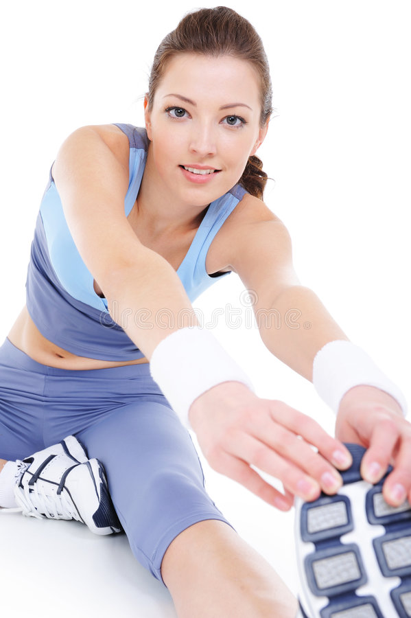 Laughing young woman doing physical stretching stock images