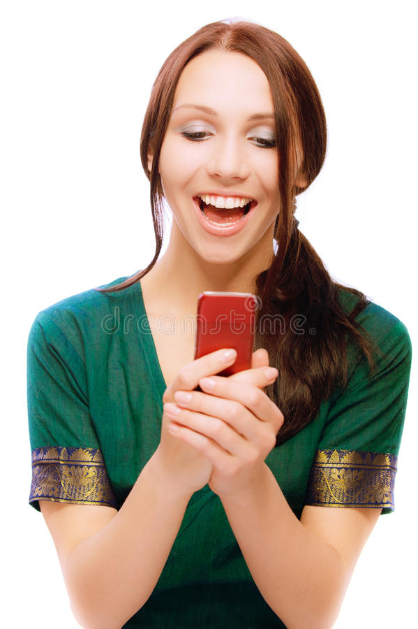 Download Laughing Young Woman Reads Sms Stock Photo - Image: 14246540