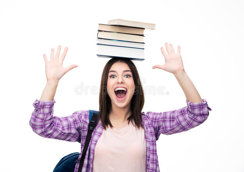 Laughing young wowan with books on head. Over white background. Looking at camera royalty free stock photography
