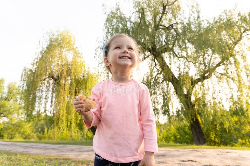 Laughting sweet little girl in summer day royalty free stock image