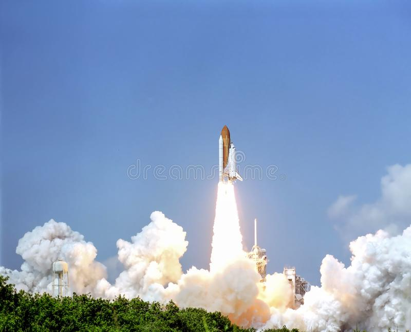 Launch of the spaceship from the spaceport by day. stock photo