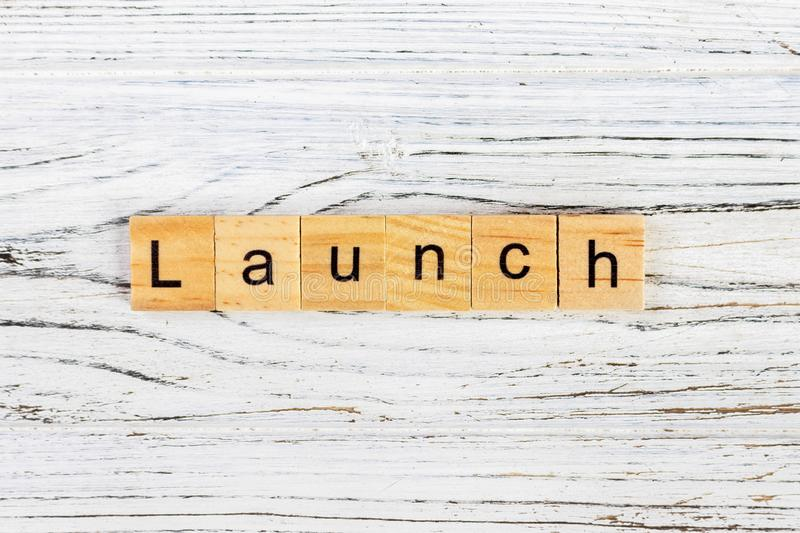 LAUNCH word made with wooden blocks concept.  royalty free stock image