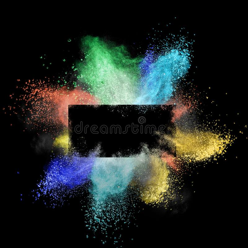 Launched colorful powder around a rectangular frame isolated on black background royalty free stock photo