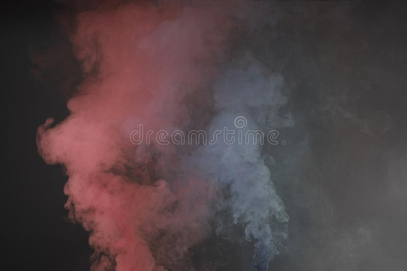 Launched colorful powder, isolated on black background royalty free stock photography
