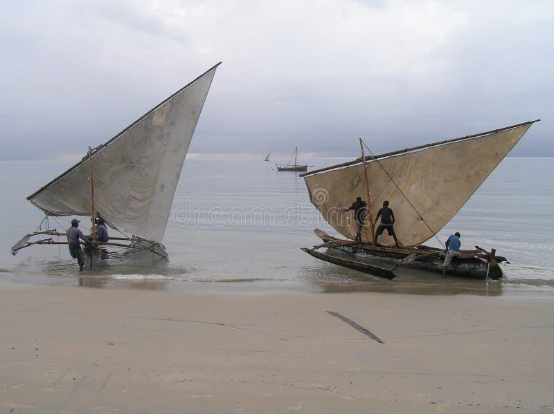 Launching the dhows, Mushono, Tanzania. Ngawalas dhows being launched by fishermen at the Mushono beach near Pangani, Tanzania royalty free stock photo