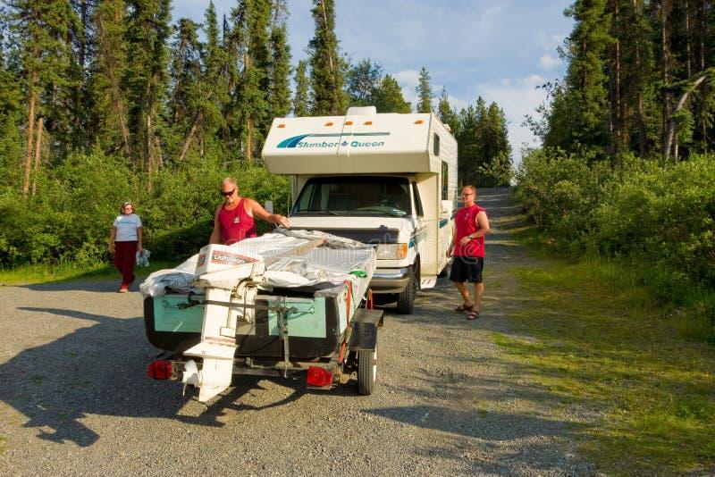 Launching a fishing boat in the yukon territories royalty free stock photo