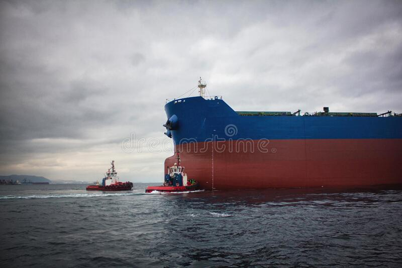 Launching of renovated tanker cargo ship from dock to water.  stock image