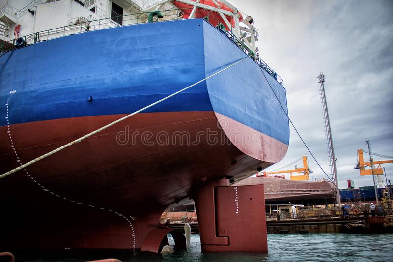 Launching of renovated tanker cargo ship from dock to water.  stock photos