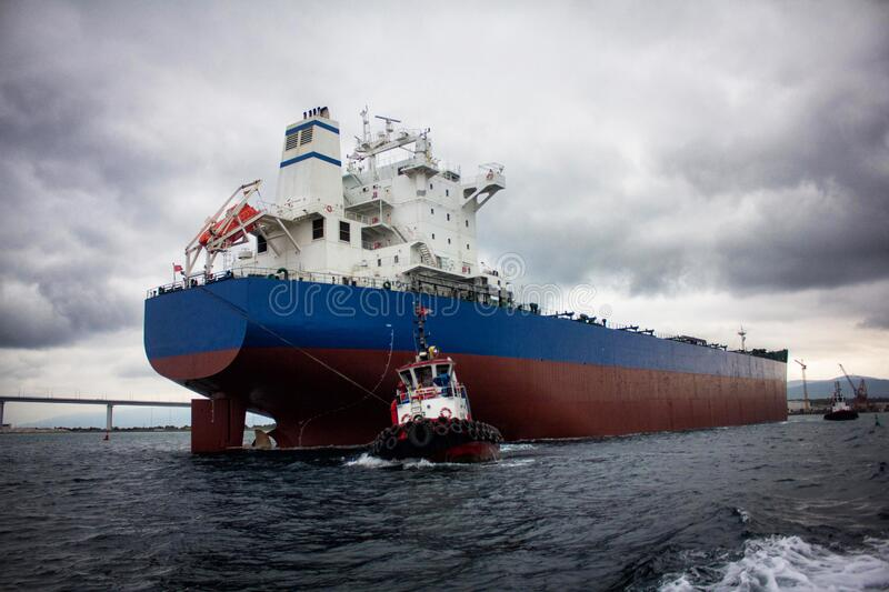 Launching of renovated tanker cargo ship from dock to water.  stock photography