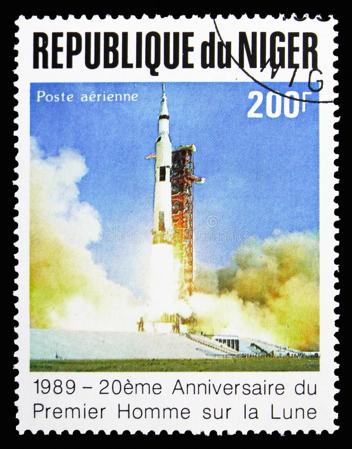 Launching rocket, 20 Anniversary of The First Manned Landing On The Moon serie, circa 1989. MOSCOW, RUSSIA - SEPTEMBER 15, 2018: A stamp printed in Niger shows stock image