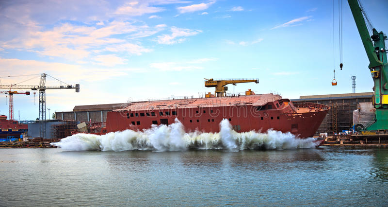 Launching a ship. The newly built vessel during launching of the shipyards stock images
