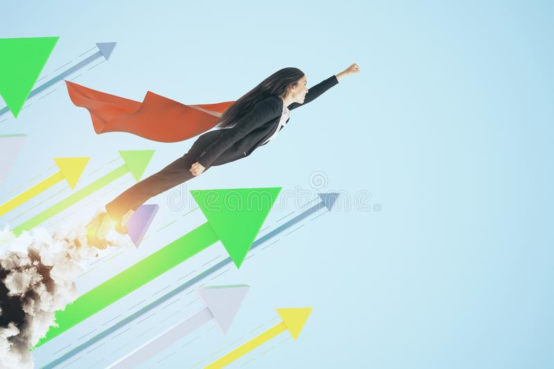 Launching super woman. Super woman launching on creative blue background with arrows. Leadership and financial growth concept royalty free stock photo