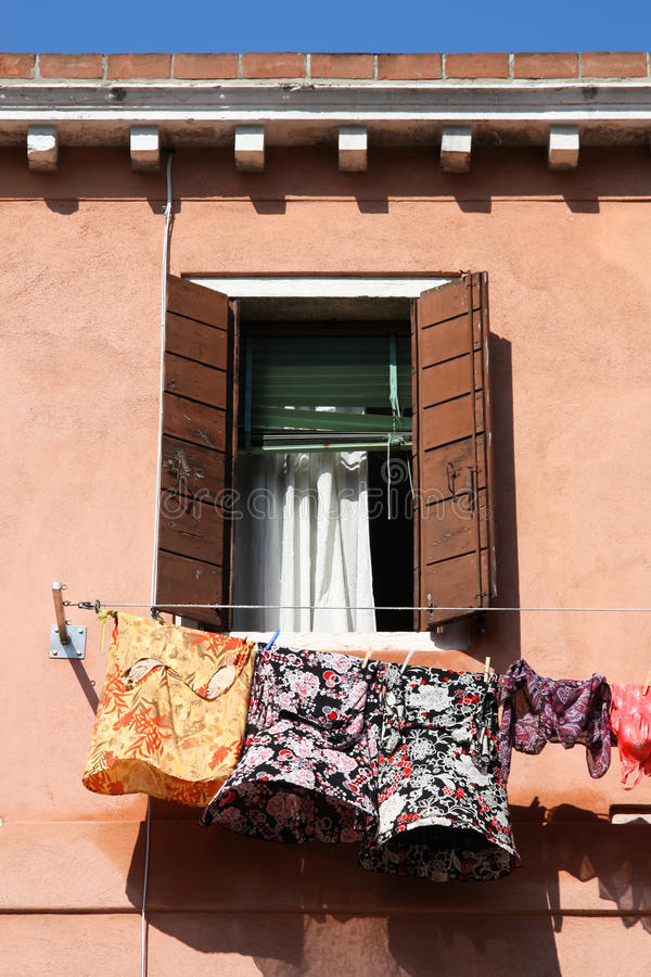 Laundry. Old building in Venice, Italy. Vintage window with colorful drying laundry stock photography