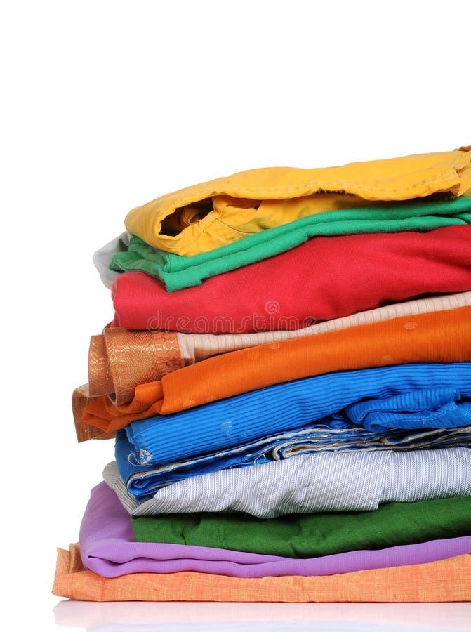 Laundry. Neatly stacked laundry dresses on white background royalty free stock image