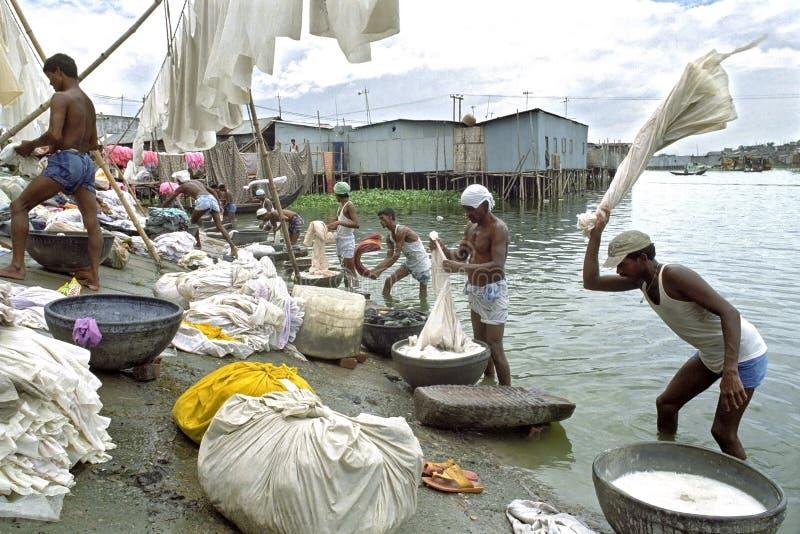 Laundry area on Buriganga River in capital Dhaka stock photos