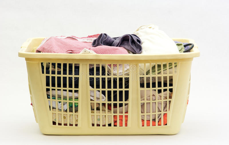 Laundry Basket. A basket of dirty Laundry with multiple color fabrics royalty free stock photos