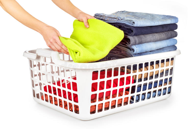 laundry basket with folded clothes over stock photo