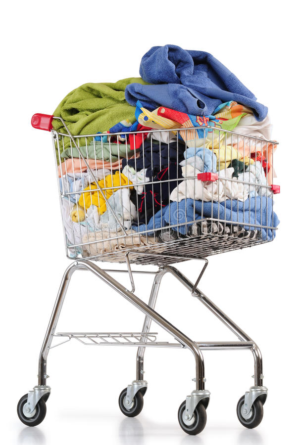 Laundry cart. Isolated. Shopping cart full of clothes isolated over white royalty free stock images