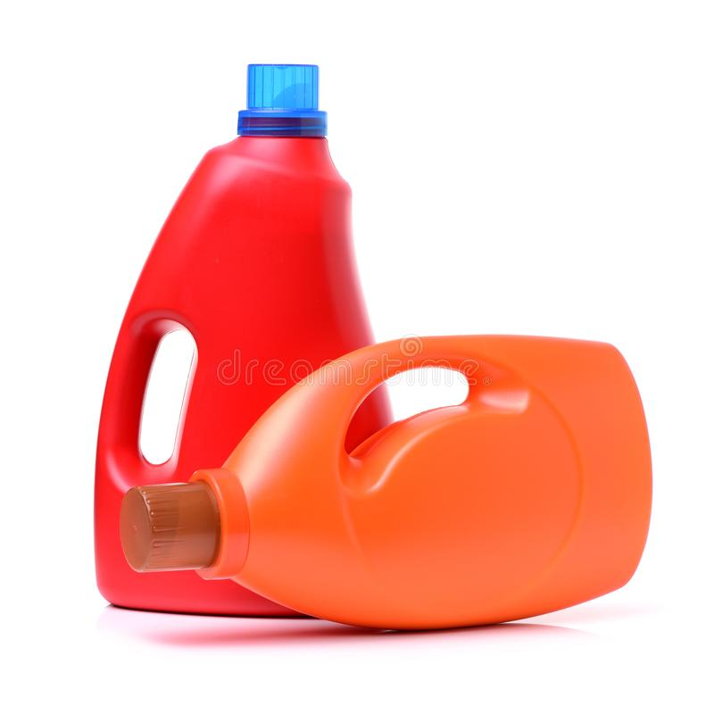Laundry detergent bottle. With fabric softener isolated on white background royalty free stock photography