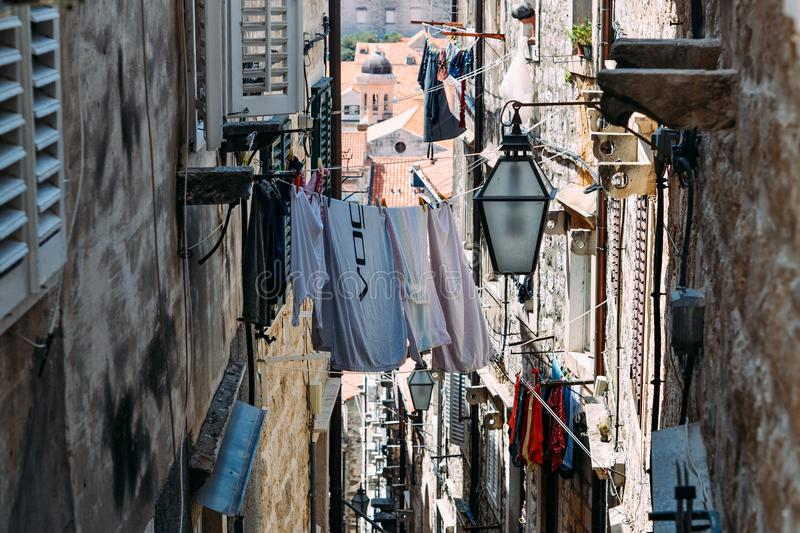 The laundry is dried in the narrow street of the old town of Dubrovnik royalty free stock images