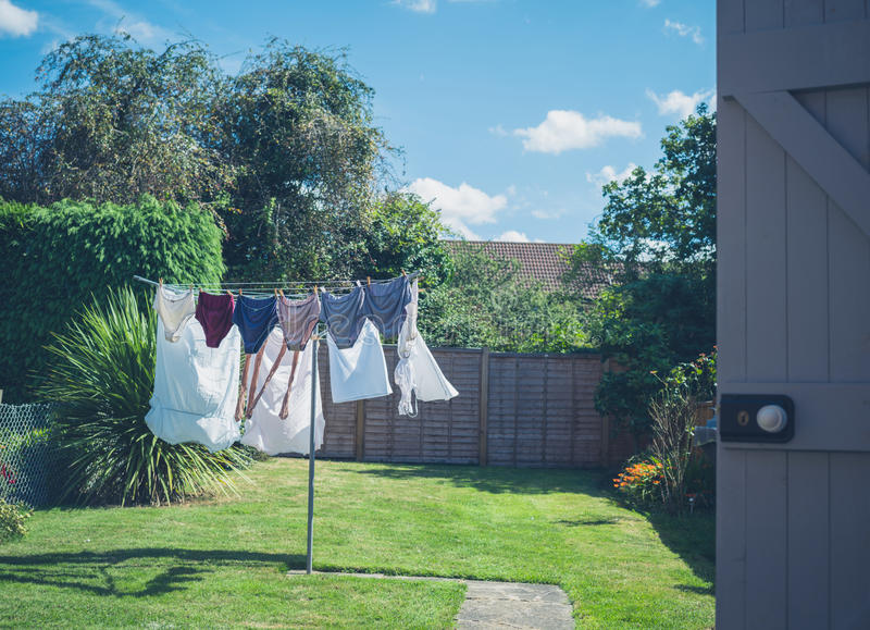 Laundry drying in garden royalty free stock photos