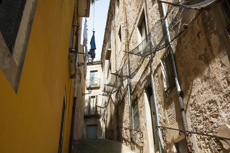 Laundry is drying on a narrow street in the center of Girona. stock images