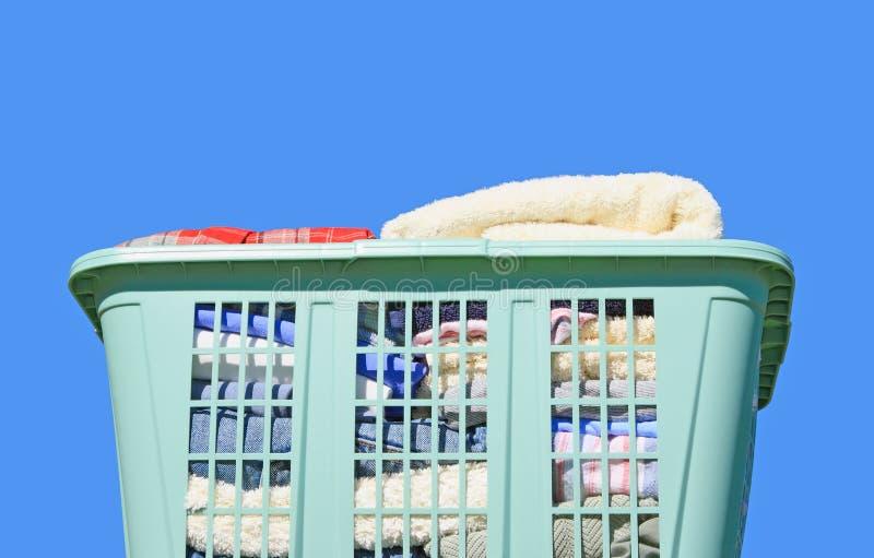Laundry in hamper stock photos