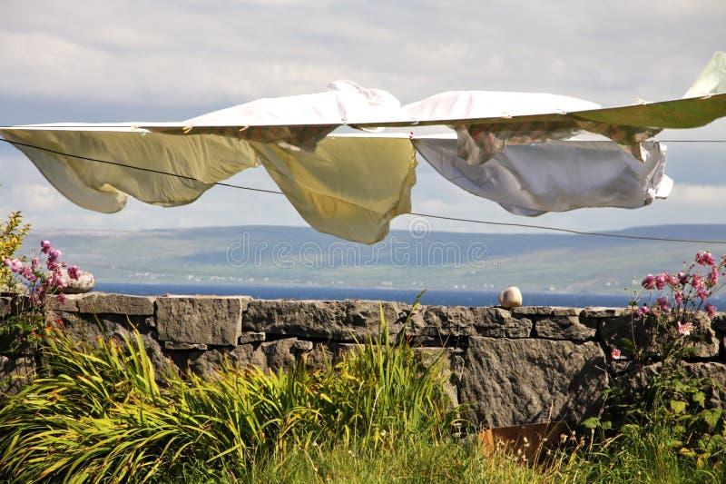Laundry hang to dry in Aran islands, Ireland. Landscape with laundry hang to dry in Inisheer village in Aran islands, Ireland royalty free stock photos