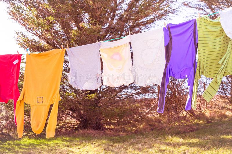 Laundry hanging out to dry outdoors in summer stock photo