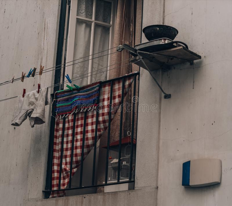 Laundry hanging outside the window on lines. In Portugal, Lisbon stock photography